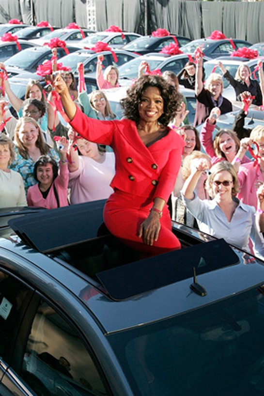 Oprah with audience members who received brand-new Pontiac G6s