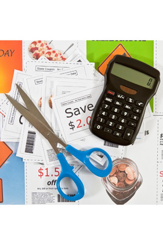 calculator, scissors and coupons