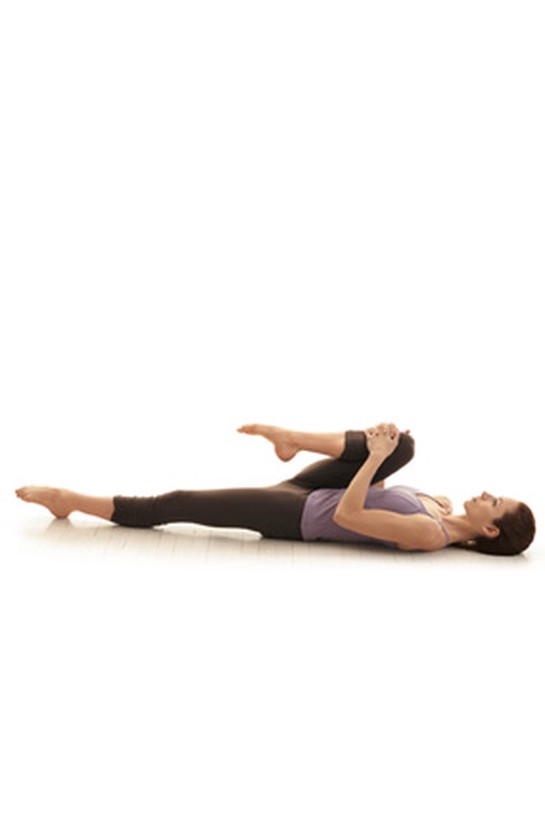 Knee hug hip release yoga pose