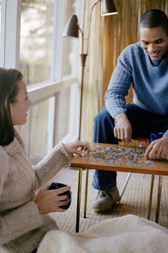 Couple doing puzzle together
