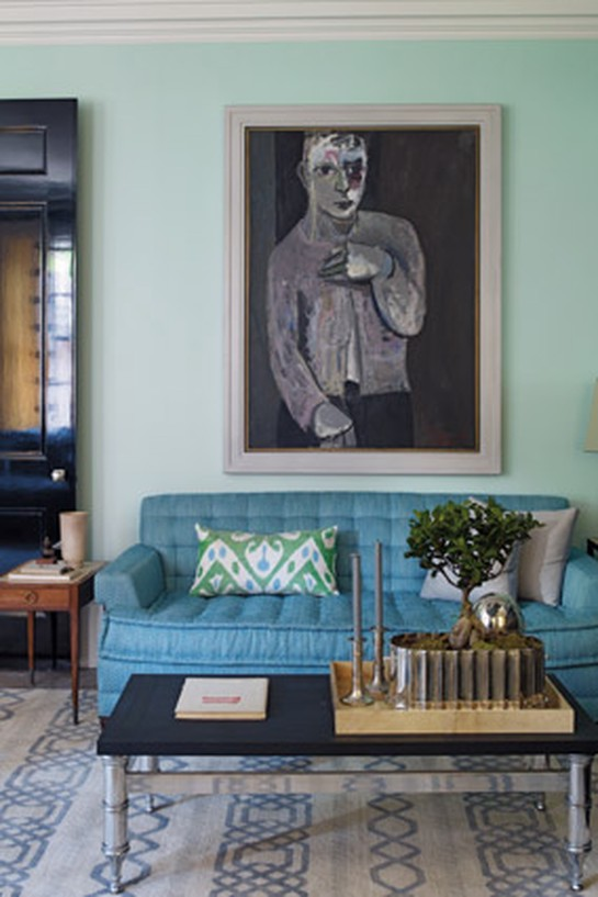 Large painting above sofa in blue-and-white living room