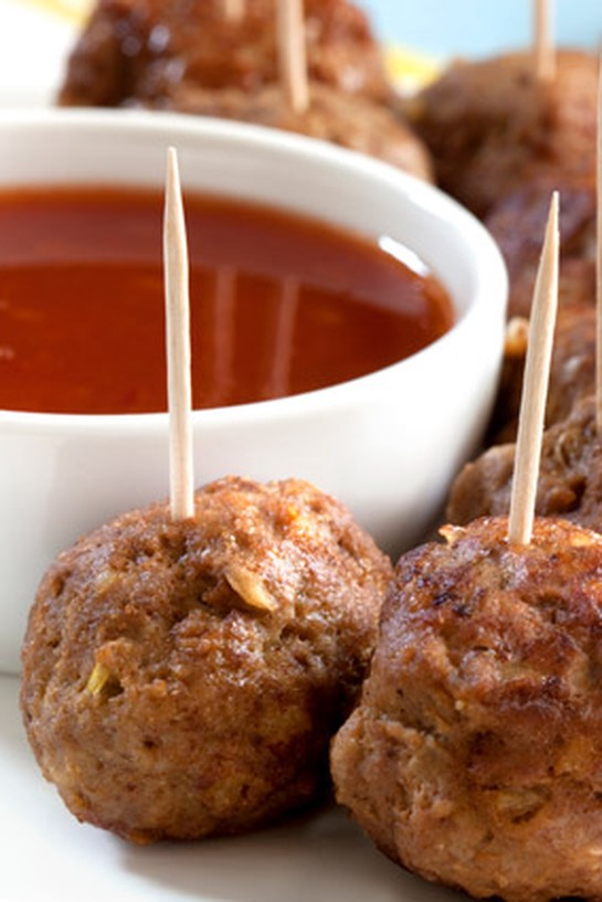 Meatballs with toothpicks and sauce