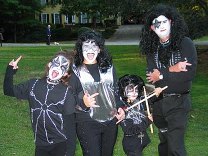 Lori and her family dressed as KISS members.