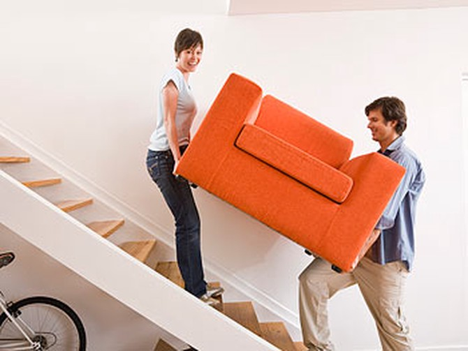 Couple carrying a couch