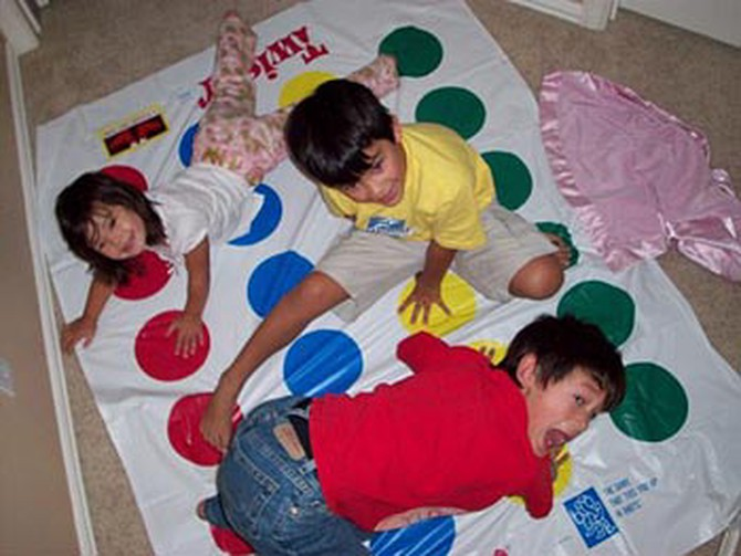 Laura's kids play Twister.