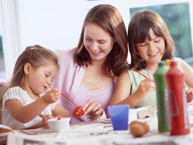 Mom painting with daughters