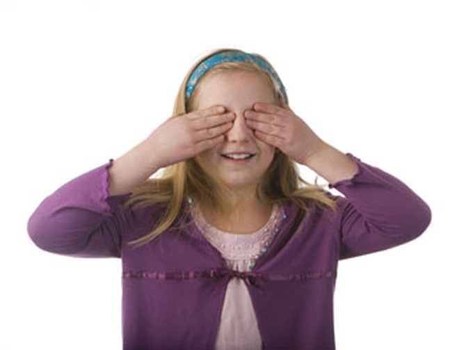 Girl playing with hands covering her eyes