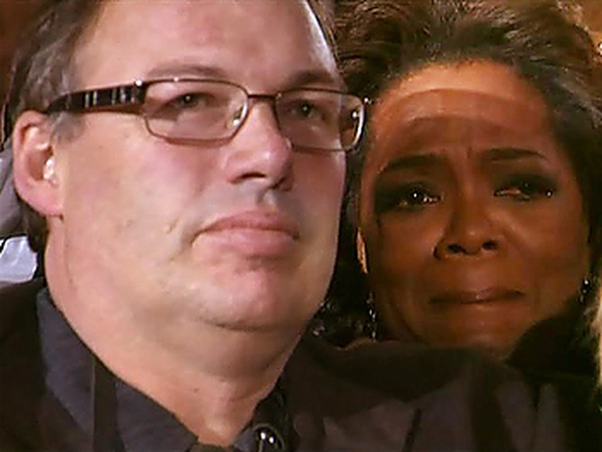 Oprah and Mr. Man watch President-elect Barack Obama in Grant Park.