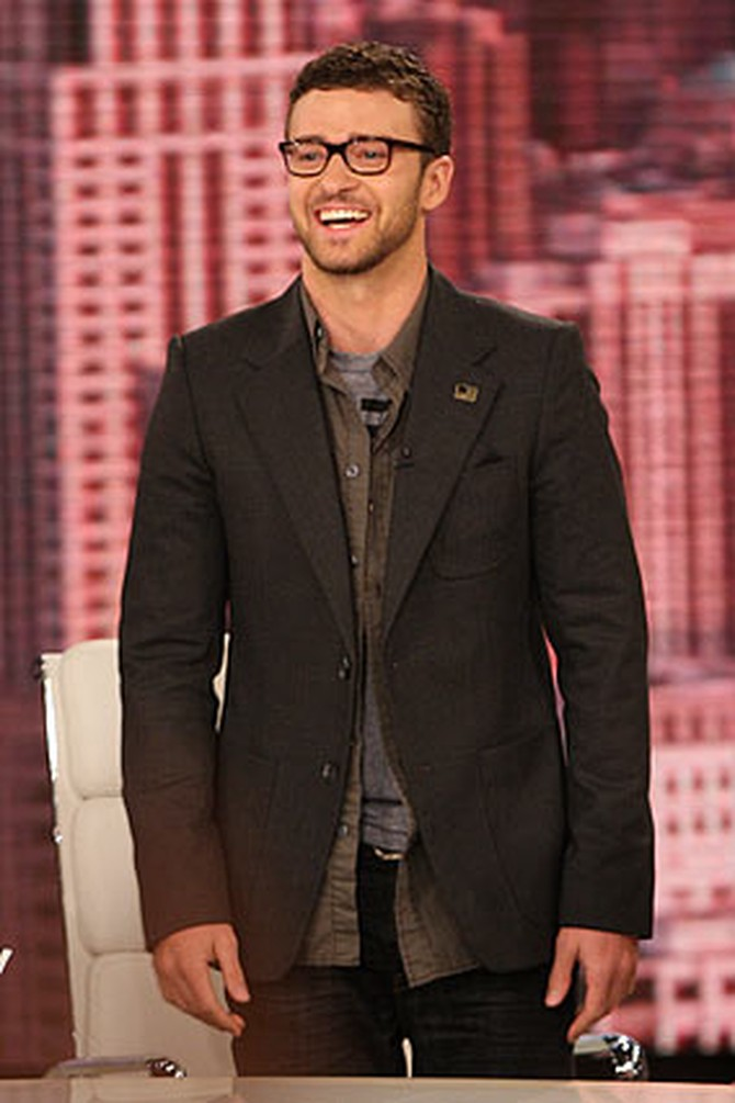 Justin Timberlake is wearing William Rast Ben jeans with a New America T-shirt and blazer.