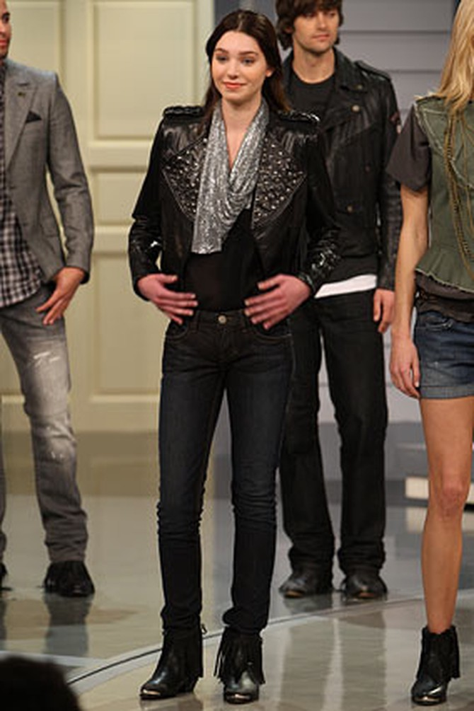A model wears William Rast's black leather jacket with studs and Jerri skinny jeans.