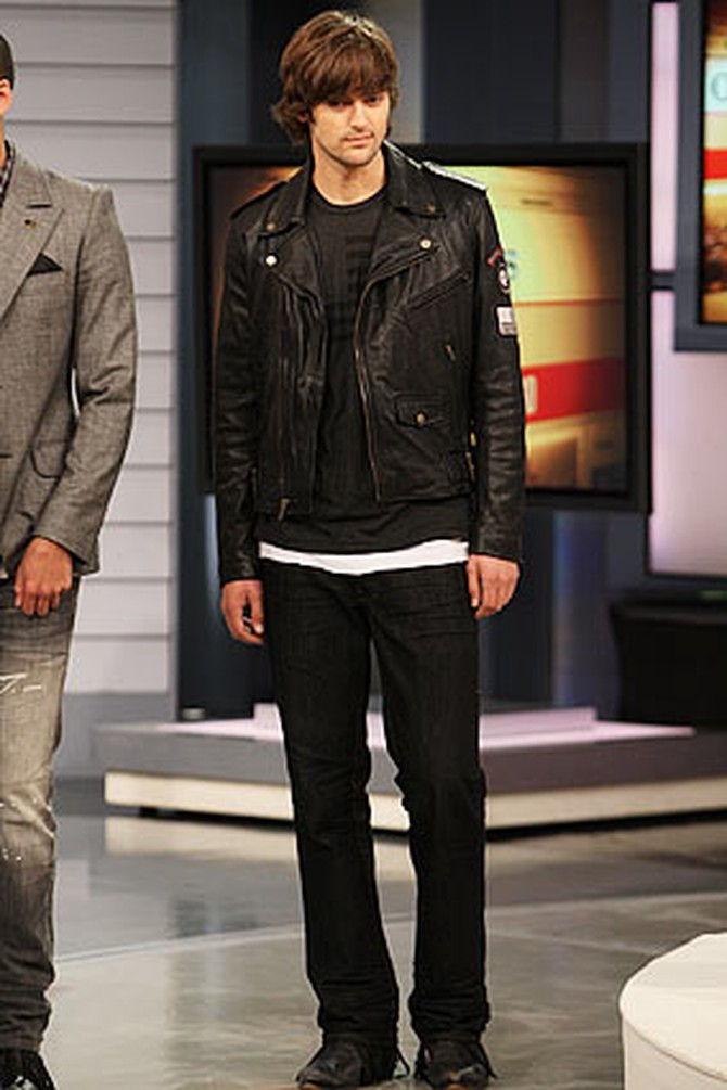 A man models Ben jeans with a William Rast leather jacket.