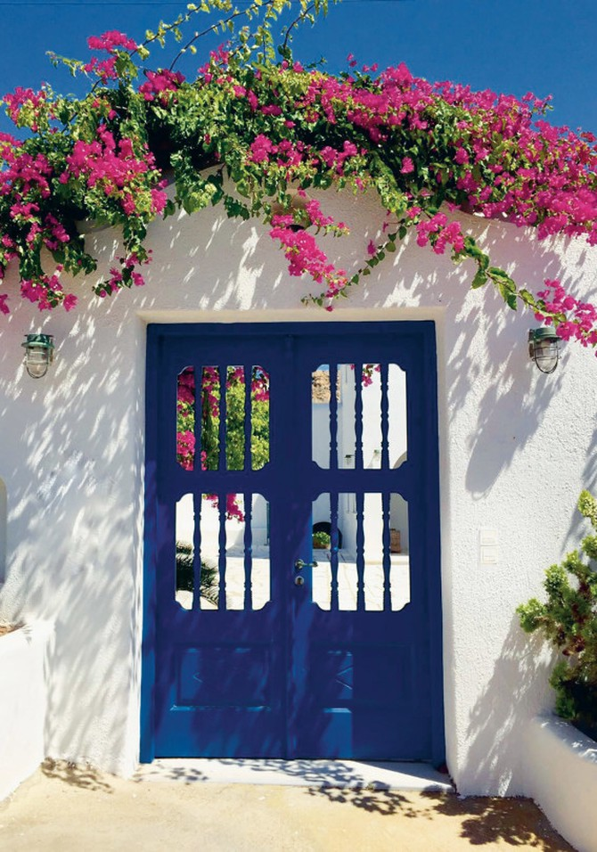 White wall and blue door in Greece