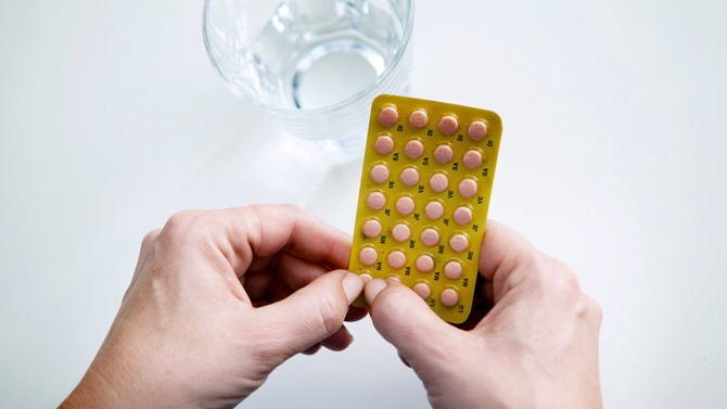 Woman taking hormone replacement pill