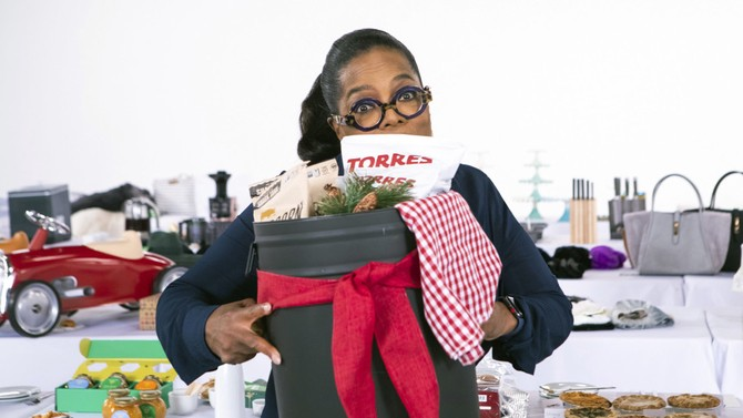 Oprah holding collection of truffle snacks