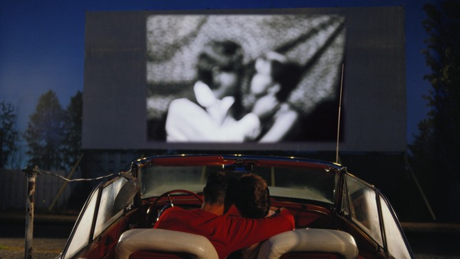 Couple enjoying a drive-in movie