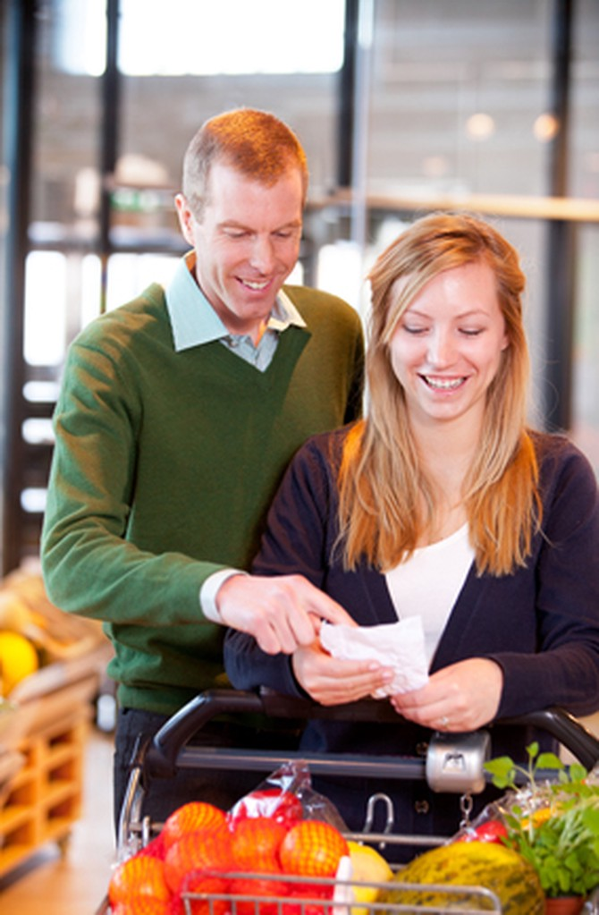 Couple looks at grocery list