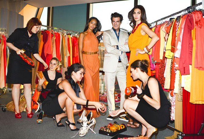 Adam Glassman with models wearing a spicy palette