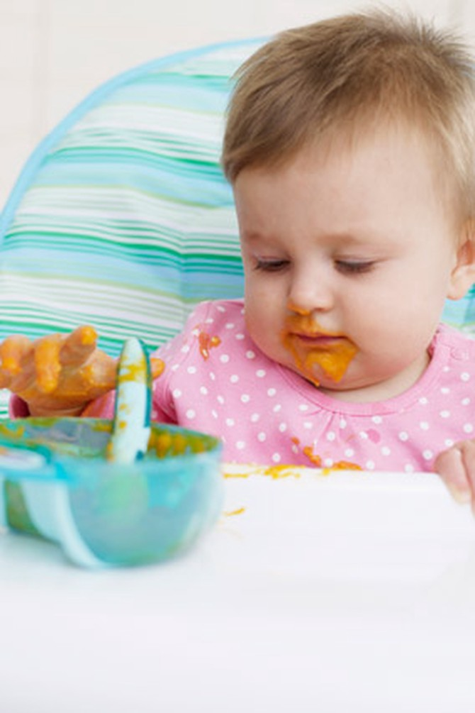 Baby eating baby food