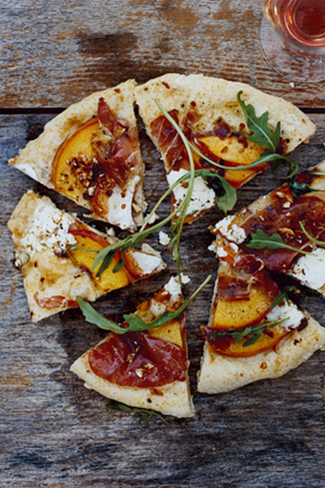 Grilled Cornmeal Flatbreads with Peaches, Serrano Ham and Spicy Greens
