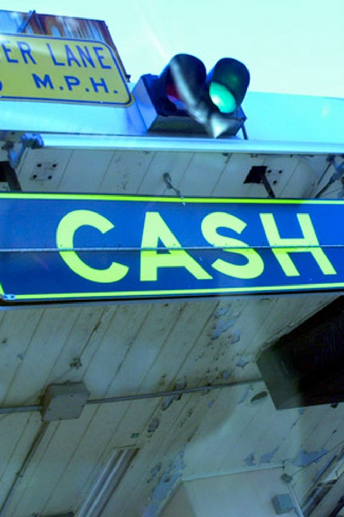 Cash toll sign