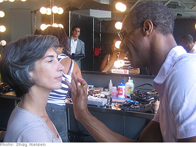 A model gets her makeup done.
