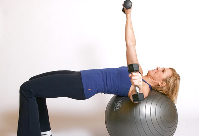 Andrea Metcalf demonstrates the single arm fly exercise.