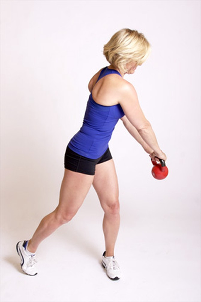 Andrea Metcalf demonstrates how to do the diagonal swing exercise using a kettlebell.