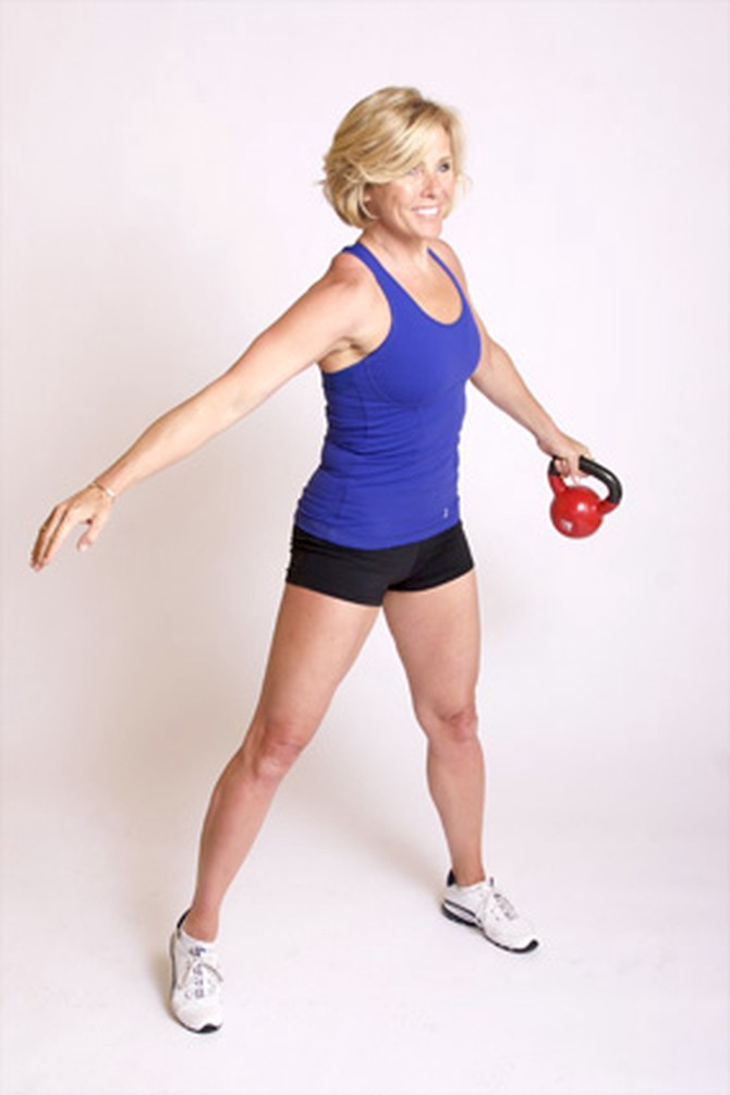 Andrea Metcalf demonstrates how to do the kettle circle exercise using a kettlebell.
