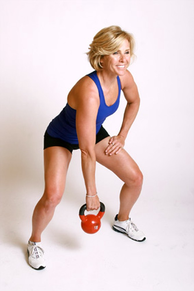 Andrea Metcalf demonstrates how to do the kettle clean exercise using a kettlebell.