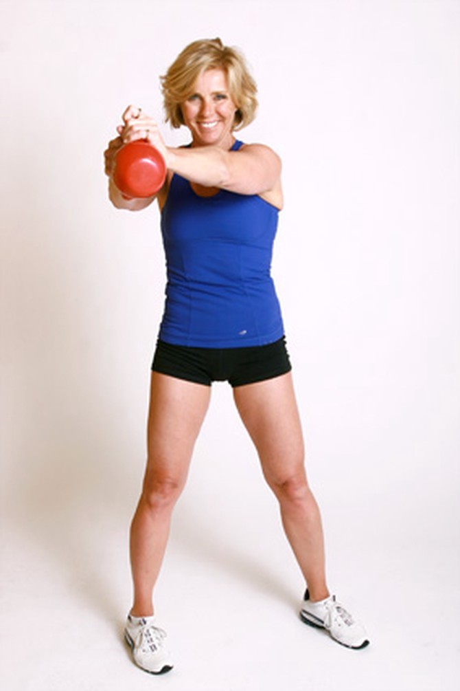Andrea Metcalf demonstrates how to do the waist swing exercise using a kettlebell.