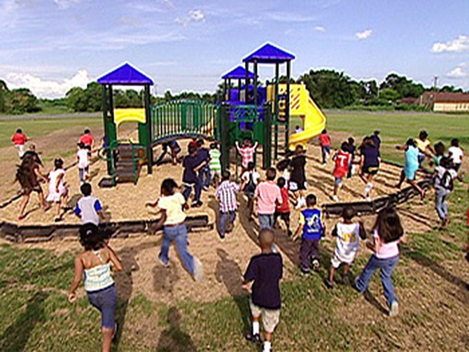 The Simms Elementary students rush the playground