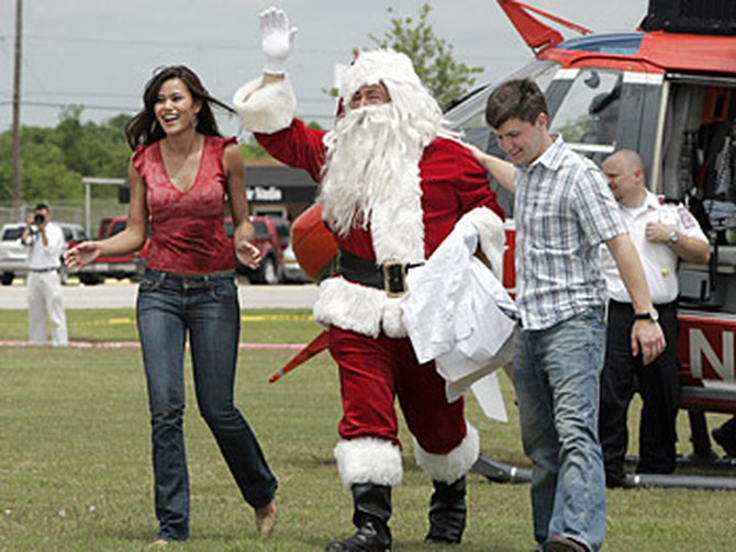 Brandi and Cameron welcome Santa