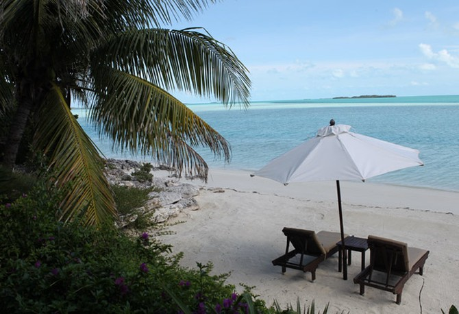 Beach chairs and umbrella on the beach of Musha Cay, David Copperfield's private island