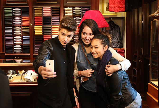 Justin Bieber takes a photo with fans