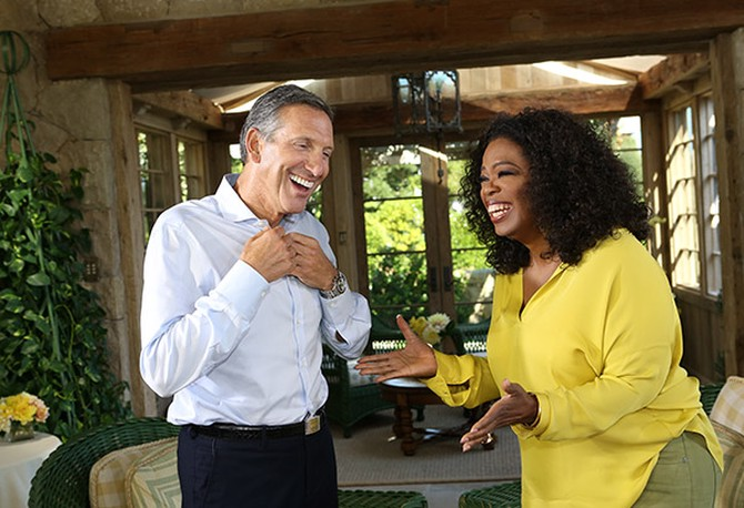 "Starbucks CEO Howard Schultz and Oprah share a laugh before their ""Super Soul Sunday"" interview"