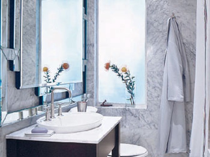 A mirror instantly enlarges a small bathroom.