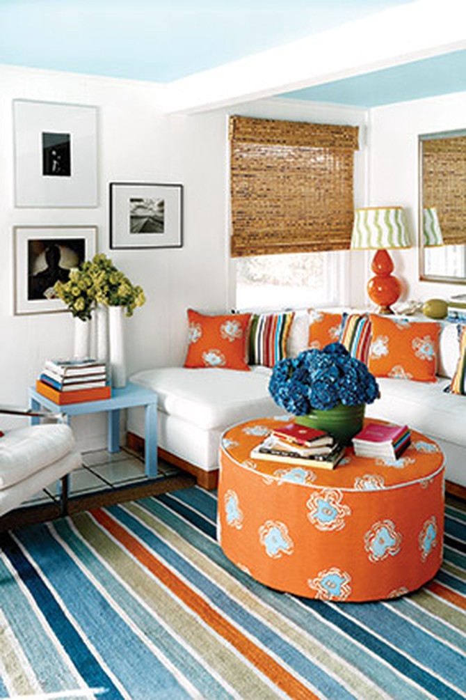 Blue-and-white living room with orange accents