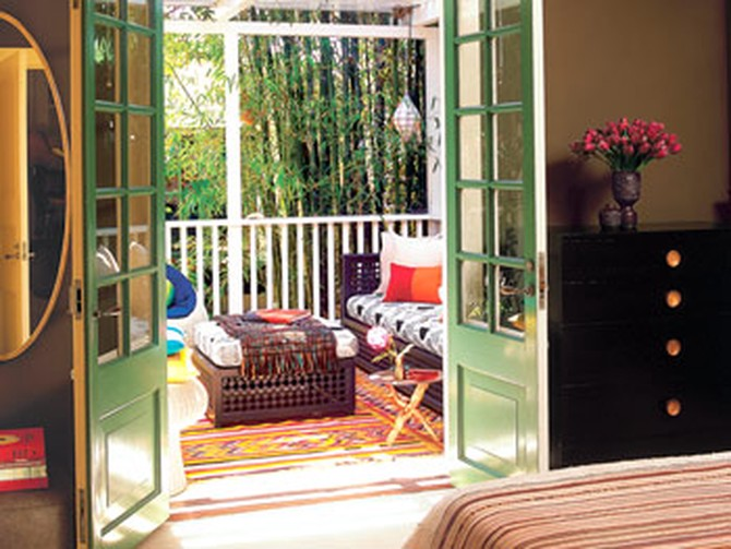 French doors allow for a bedroom that is open and intimate at the same time.