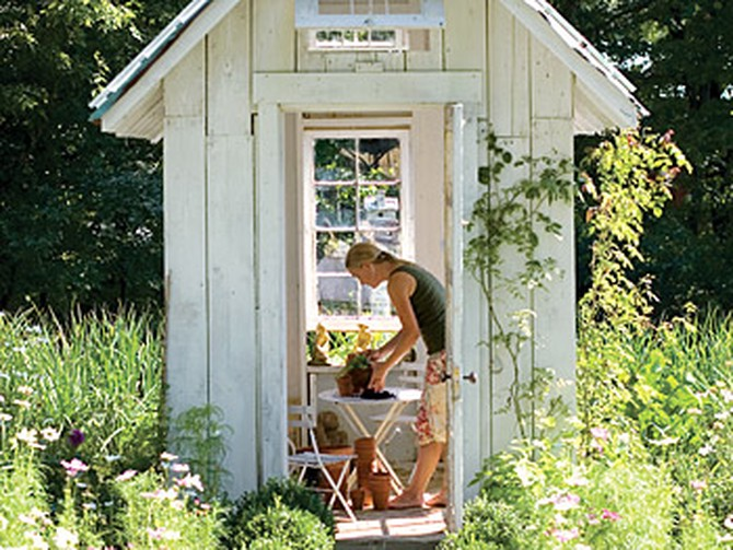 Amy works on gardening projects in the small potting shed that Paul built.