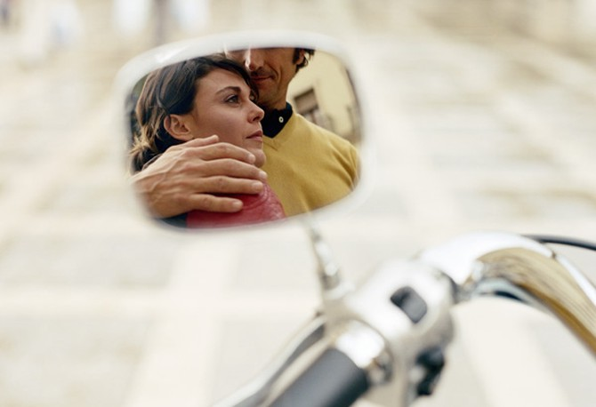 Reflection of man and woman hugging