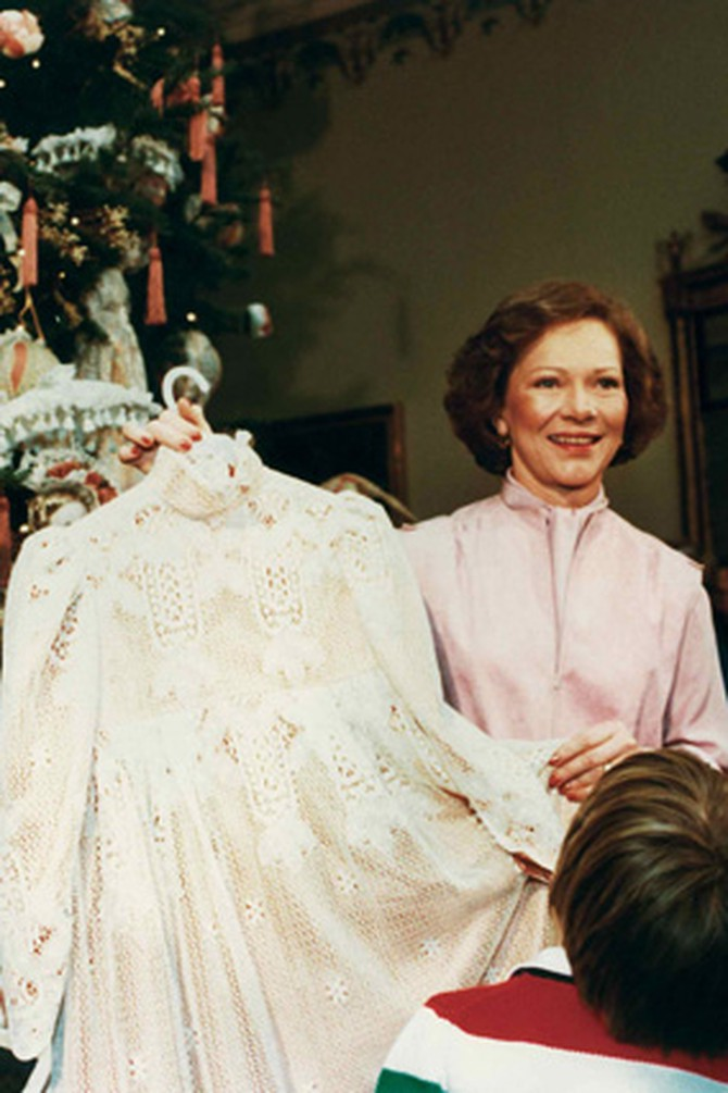 First Lady Rosalynn Carter displays a ball gown made for daughter Amy.