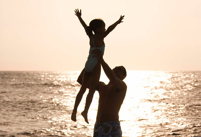 Father lifting up daughter