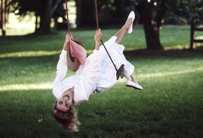 Happy woman in swing