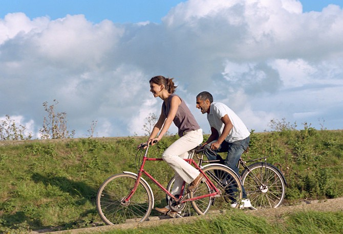 Woman and man riding bikes