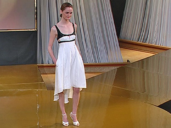 Lisa models a Narciso Rodriguez dress.