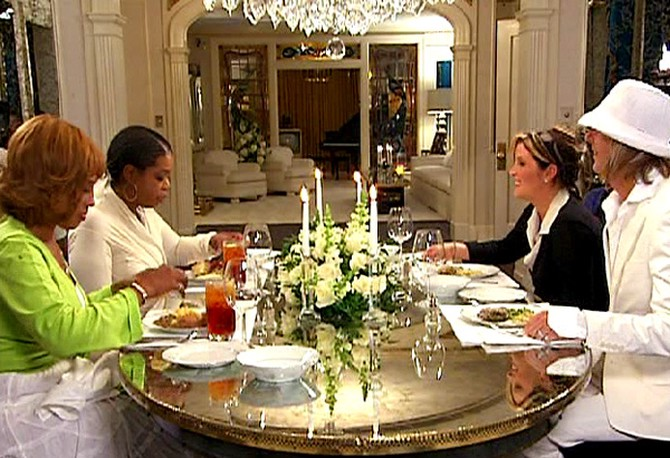 Lisa Marie and her husband, Michael, dine with Oprah and Gayle.