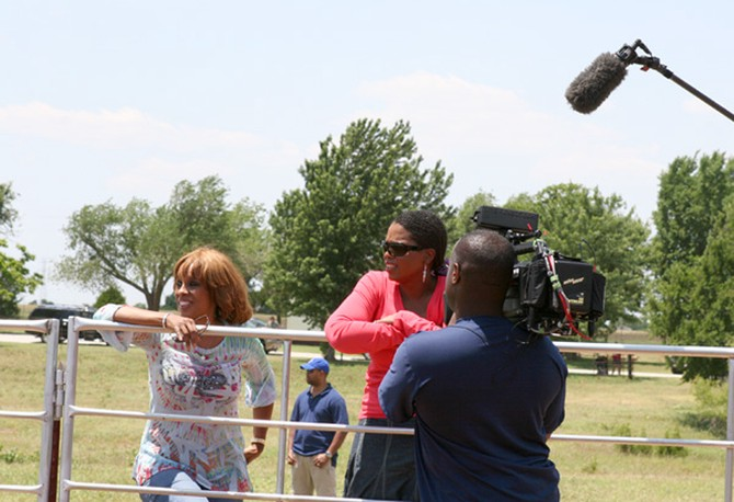 Gayle and Oprah enjoy watching some cattle-roping
