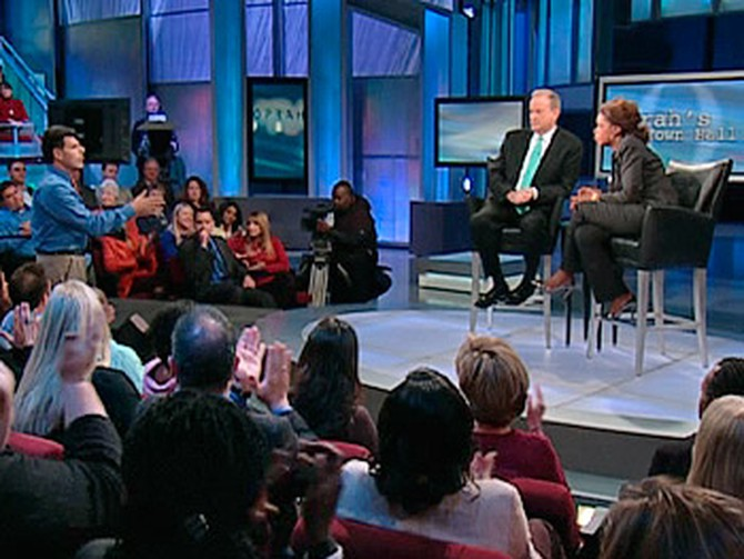 Bill O'Reilly and Oprah talk with the audience.