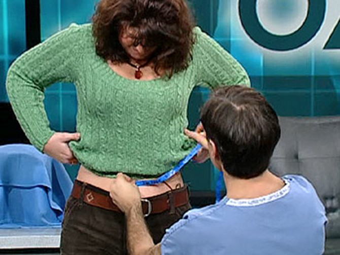 Dr. Oz helps a woman measure her waist