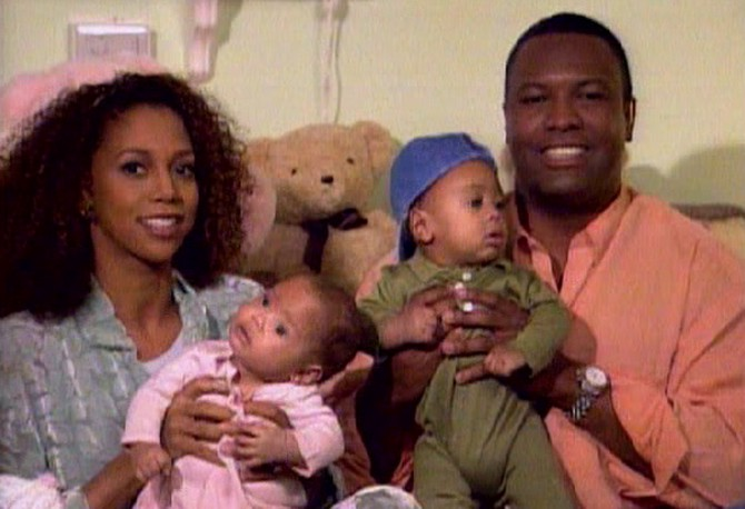 The Peetes holding twins Rodney and Ryan